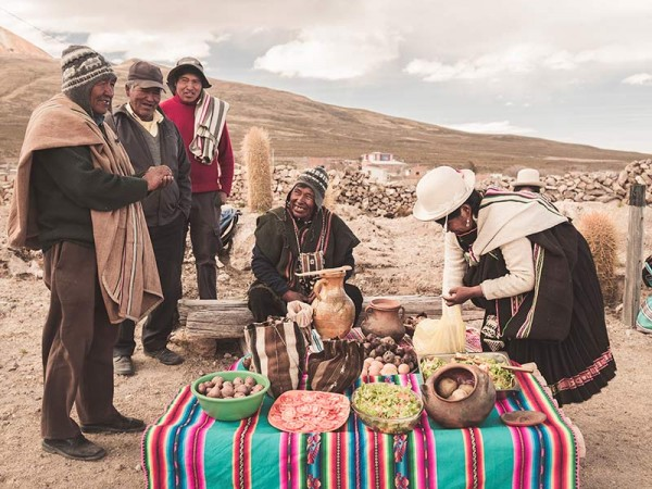 Members of the community sharing the traditional Apthapi